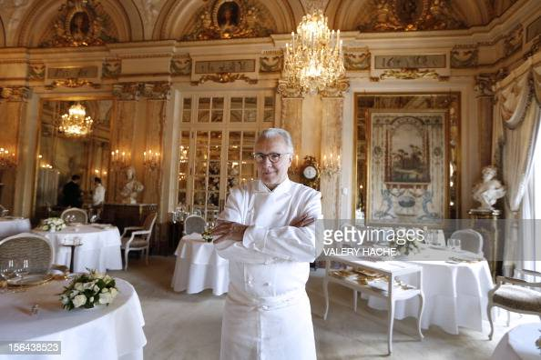 French chef Alain Ducasse poses in the 'Louis XV' restaurant in the Hotel de Paris in Monaco which will be celebrating its 25th anniversary AFP PHOTO...