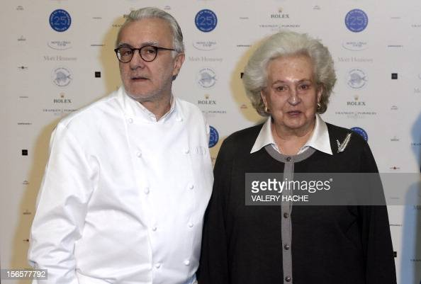 French chef Alain Ducasse poses with Spain's Infanta Pilar during festivities marking the 25th anniversary of his restaurant Le Louis XV on November...