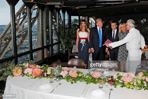 French Chef Alain Ducasse welcomes French President Emmanuel Macron his wife Brigitte Macron US President Donald Trump and First Lady Melania Trump...