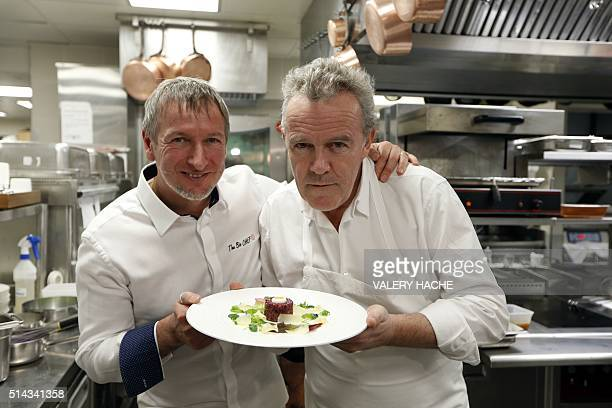French chef Alain Passard and Italian chief Paolo Sari pose on March 8 before the '4 hands and 4 stars' dinner at the 'Monte Carlo Beach restaurant'...