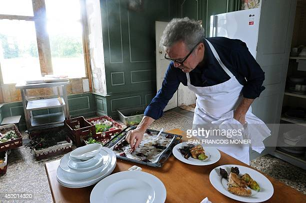 French chef Alain Passard cooks in his kitchen in FillesurSarthe western France on July 9 2014 Since 2002 Passard the head of the three Michelin...