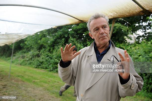 French chef Alain Passard speaks in his vegetable garden in FillesurSarthe western France on July 9 2014 Since 2002 Passard the head of the three...