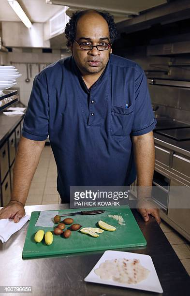 French chef Antoine Heerah native of Mauritius prepares an Australian Finger Lime also know as 'lime caviar' on December 19 2014 in Paris AFP PHOTO /...