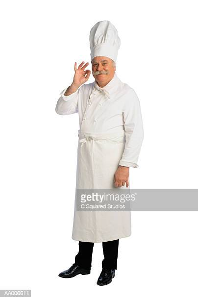 French Chef Gesturing to the Quality of His Food