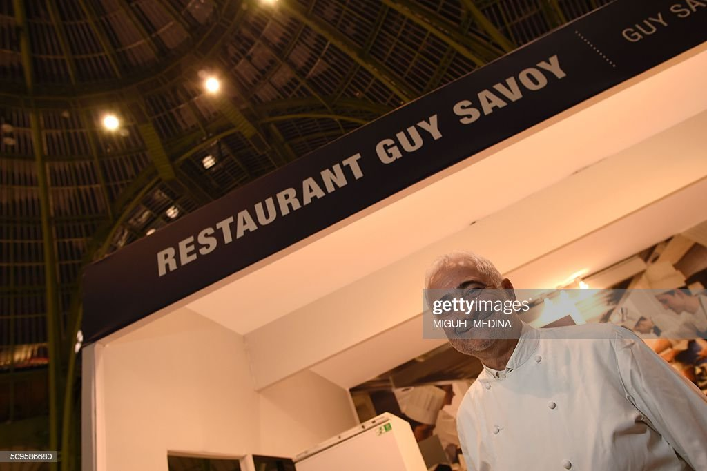French chef Guy Savoy poses for a photograph after the innauguration of the Taste of Paris, Festival of Chefs, at the Grand Palais in Paris on February 11, 2016. / AFP / MIGUEL MEDINA