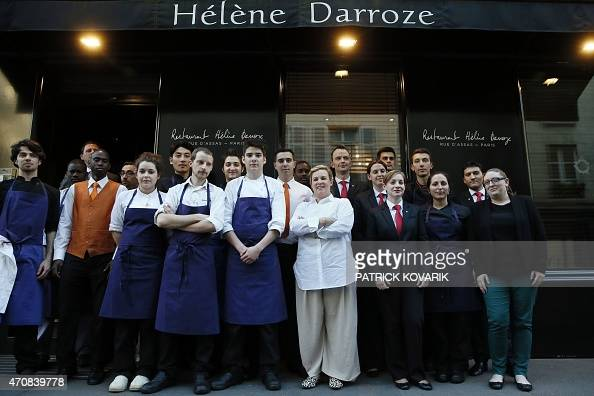 french chef helene darroze c poses with her staff in front her restaurant in paris on april 23. Black Bedroom Furniture Sets. Home Design Ideas