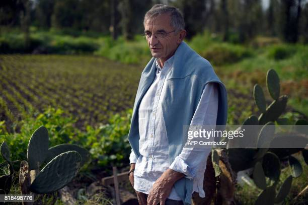 French chef Michel Bras poses for pictures during a symposium on biodiversity and gastronomy amid the floating gardens of Xochimilco a UNESCO World...