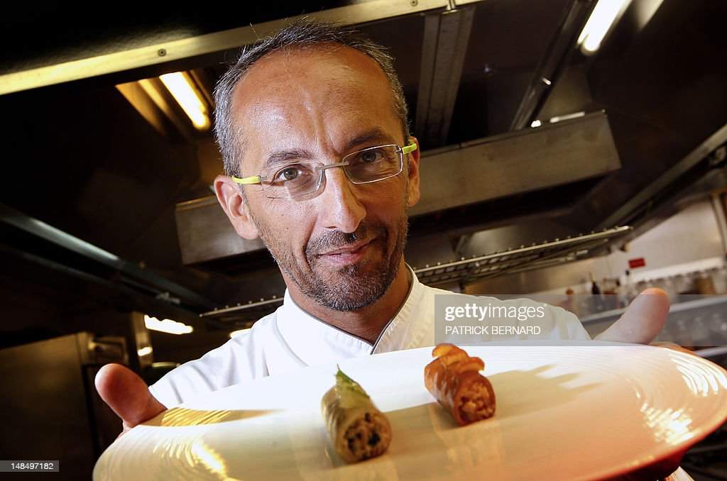 French Chef, Michel Portos, Best Cook Award 2012 and two-star ranking in the Michelin gastronomy guide, poses on July 16, 2012 at his restaurant, The Saint-James, in Bouillac, near Bordeaux, western France. Portos will move at the end of the year to his hometown in Marseille, southern France.