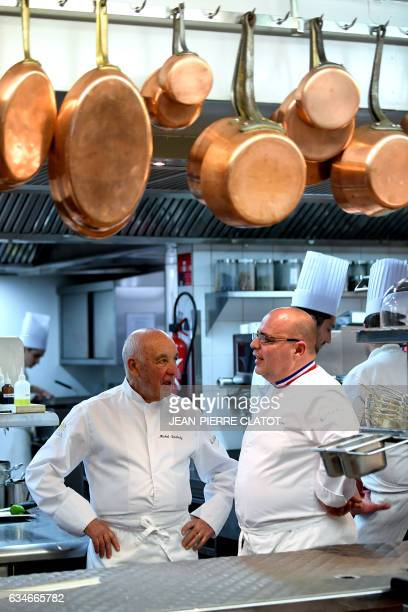French chef Michel Rochedy and his assistant Stephane Buron speak in the kitchen of the twostar gourmet restaurant of the fourstar hotel 'Le...