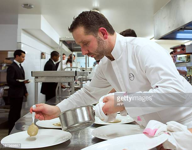 French chef Olivier Arlot prepares food in the kitchen of the restaurant 'Les Hautes Roches' on November 7 2013 in Rochecorbon near Tours central...