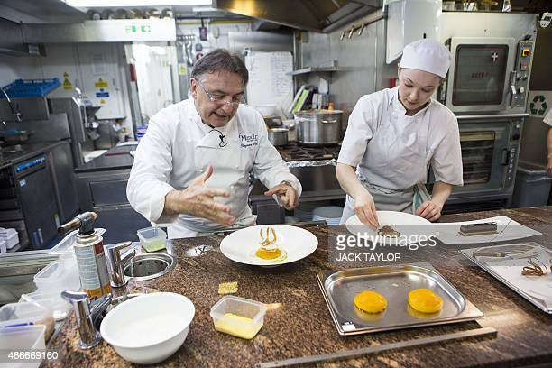 Scenic Raymond Blanc Stock Photos And Pictures  Getty Images With Goodlooking French Chef Raymond Blanc Prepares A Dessert With Another Chef In The  Kitchen Of His Restaurant With Cool Wooden Garden Tables Uk Also Garden For Children In Addition Pubs Near Covent Garden And Garden Clearance Glasgow As Well As Garden Clearance Additionally Garden Paving Stones From Gettyimagescom With   Goodlooking Raymond Blanc Stock Photos And Pictures  Getty Images With Cool French Chef Raymond Blanc Prepares A Dessert With Another Chef In The  Kitchen Of His Restaurant And Scenic Wooden Garden Tables Uk Also Garden For Children In Addition Pubs Near Covent Garden From Gettyimagescom