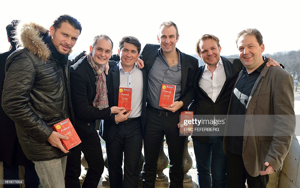 French chiefs (From L) Glenn Viel (Courchevel), Alexandre Couillon (Noirmoutier), William Frachot (Dijon), Yoann Conte (Veyrier-du-Lac), Nicolas Sale (from the 'Terrasses du Kilimandjaro' restaurant) and Sylvain Guillemot (Noyal-sur-Vilaine), pose for a picture after being awarded by France's gastronomy bible, the Michelin Guide, on February 18, 2013 in Paris.