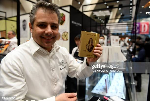 French chocolatier Hugues Pouget of Hugo Victor Paris poses at his booth during the 15th Salon du Chocolat trade show in Tokyo on February 1 2017...