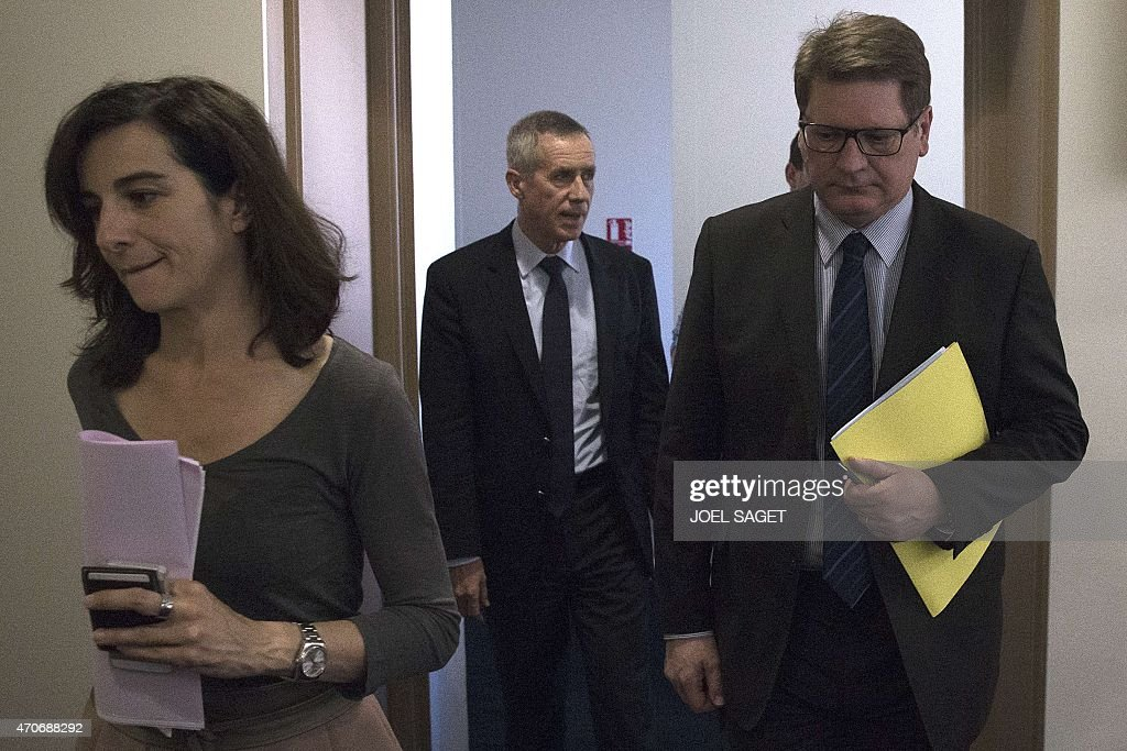 French Christian Sainte (R), head of French criminal police, and Paris Prosecutor Francois Molins (C) arrive for a press conference at the Paris court on April 22, 2015, following the arrest of an IT student who allegedly planned a church attack in France, just over three months after Paris was hit by a jihadist killing spree. French police found Arabic documents mentioning the Islamic State group and Al-Qaeda at the home of the Algerian student, Sid Ahmed Ghlam, suspected of plotting an attack against a French church, Paris Prosecutor said. SAGET