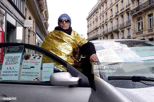 MURUTAMPUNZI French Christiane Leveuf who was infected with hepatitis C through a blood transfusion in the 80s poses next to her car outside the...