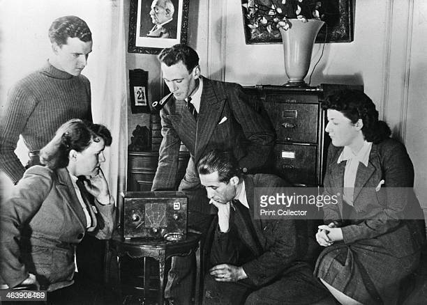 French citizens listening to a broadcast by Vichy deputy premier Admiral Francois Darlan 23 May 1941