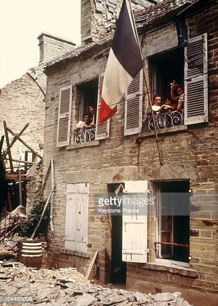 French civilians going back to their homes in Cherbourg after the Allied landing in June 1944
