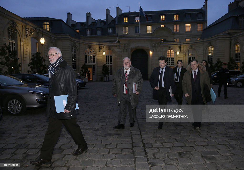 French Claudy Lebreton (L), head of French departments Assembly, and a delegation of local representatives, arrive on January 28, 2013, in Paris, at the Hotel Matignon, the Prime Minister official residence, to attend a meeting to set up a working committee between French State and departements of France. AFP PHOTO JACQUES DEMARTHON