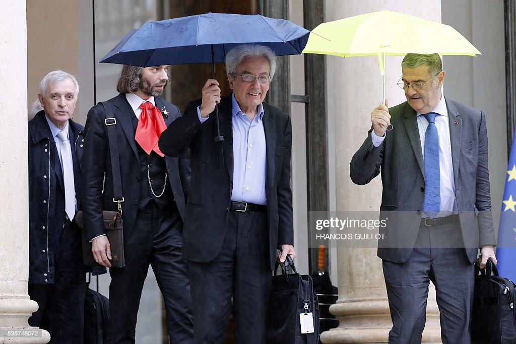 French climatologist and glaciologist Jean Jouzel, French mathematician Cedric Villani, French physicist Albert Fert and French physicist Serge Haroche leave the Elysee palace in Paris following a meeting with the French President on May 30, 2016 following an article, signed by seven Nobel Prize winners and one Fields medal winner, published in the French newspaper Le Monde regarding the draft decree of budget cuts in research and higher education. French President Francois Hollande has removed credit cuts of 134 millions of euros from the budget of the research, said Nobel Prize winner Serge Haroche after having been received at the Elysee Palace with five other leading scientists.