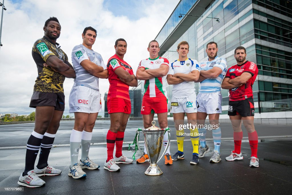 French club captains Fulgence Ouedraogo of Montpellier, Matthias Rolland of Castres Olympique, Thierry Dusautoir of Stade Toulousain, Imanol Harinordoquy of Biarritz Olympique PB, Aurelien Rougerie of ASM Clermont Auvergne, Jacques Cronje of Racing Metro 92 and Sebastien Tillous Bordes of RC Toulon pose with the Heineken Cup during the Heineken Cup Launch at France Television HQ on September 24, 2012 in Paris, France.