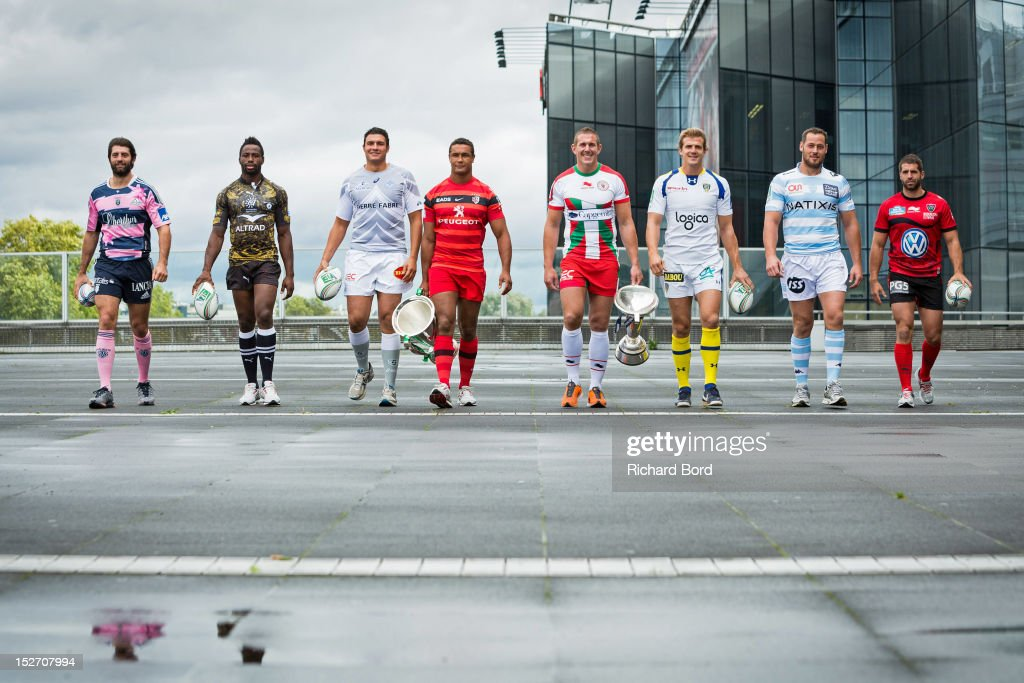 French club captains Pierre Rabadan of Stade Francais Paris, Fulgence Ouedraogo of Montpellier, Matthias Rolland of Castres Olympique, Thierry Dusautoir of Stade Toulousain, Imanol Harinordoquy of Biarritz Olympique PB, Aurelien Rougerie of ASM Clermont Auvergne, Jacques Cronje of Racing Metro 92 and Sebastien Tillous Bordes of RC Toulon pose with the Heineken Cup and the Amlin Challenge Cup during the Heineken Cup Launch at France Television HQ on September 24, 2012 in Paris, France.