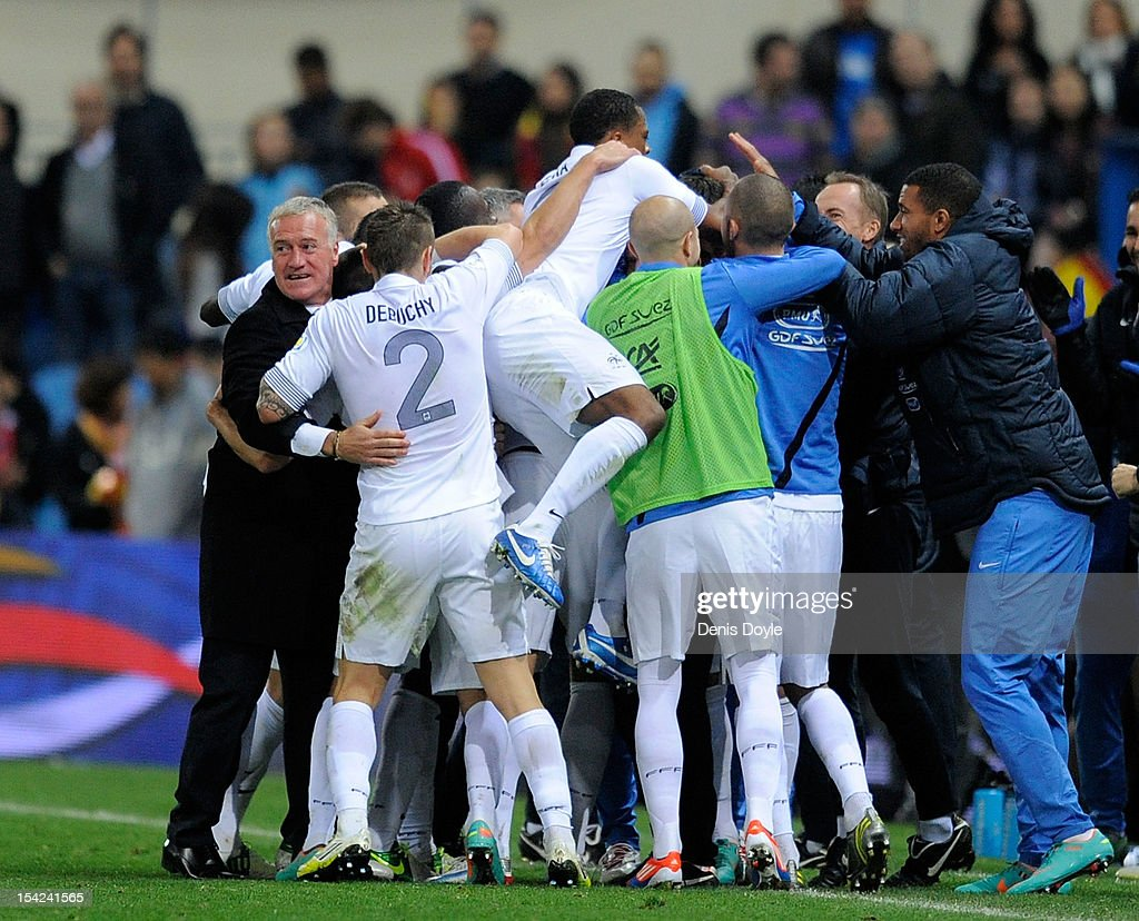 French coach <a gi-track='captionPersonalityLinkClicked' href=/galleries/search?phrase=Didier+Deschamps&family=editorial&specificpeople=213607 ng-click='$event.stopPropagation()'>Didier Deschamps</a> (L) celebrates after Olivier Giroud scored France's equalizing goal during the FIFA 2014 World Cup Qualifier between Spain and France at estadio Vicente Calderon on October 16, 2012 in Madrid, Spain. The match ended a 1-1 draw.