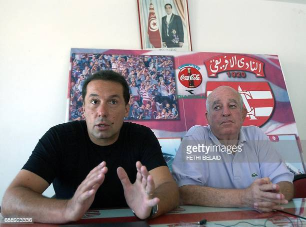 French coach Henry Stambouli and Cherif Bellamine head of Tunis football Club Afrcain give a press conference after having signed a twoyear contract...
