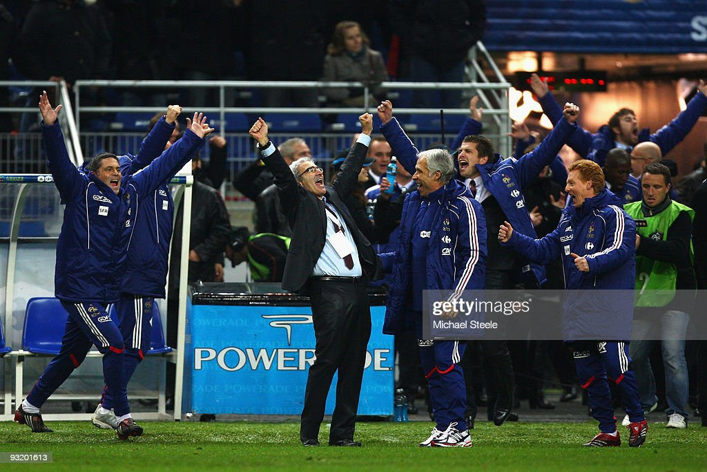 French Coach <a gi-track='captionPersonalityLinkClicked' href=/galleries/search?phrase=Raymond+Domenech&family=editorial&specificpeople=497446 ng-click='$event.stopPropagation()'>Raymond Domenech</a> (2nd L) celebrates at the final whistle after the 1-1 draw which saw his team win 2-1 on aggregate during the France v Republic of Ireland FIFA 2010 World Cup Qualifying Play Off second leg match at the Stade de France on November 18, 2009 in Paris, France.