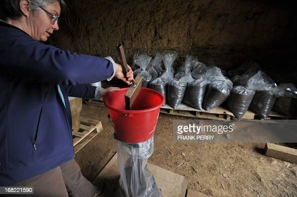 French cofounder of a lombricole farm in Lanouee western France Gwenola Picard fills bags with manure on May 2 2013 Earthworms produce manure drain...