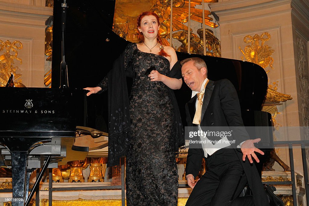 French coloratura soprano, Patricia Petibon (L) and countertenor Robert Expert perform in the Royal Chapel prior to the gala dinner of Professor David Khayat's association 'AVEC', at Chateau de Versailles on February 4, 2013 in Versailles, France.