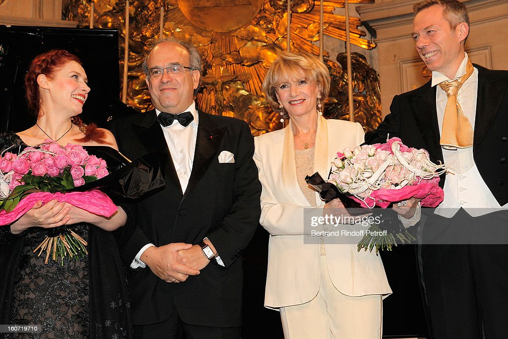 French coloratura soprano, Patricia Petibon, Professor David Khayat, Eve Ruggieri and countertenor Robert Expert pose after Petibon and Expert performed in the Royal Chapel, prior to the gala dinner of Khayat's association 'AVEC', at Chateau de Versailles on February 4, 2013 in Versailles, France.
