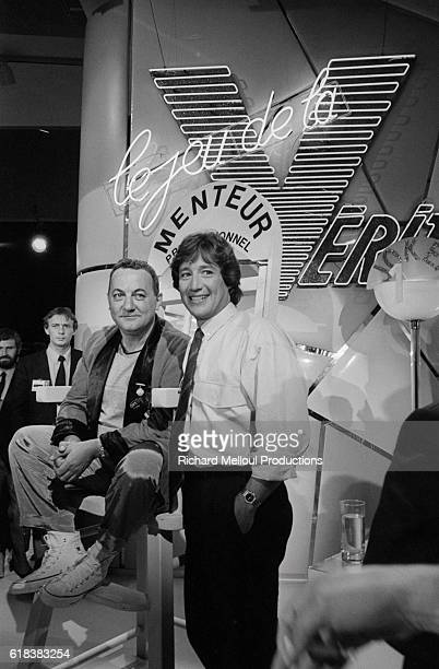 French comedian Coluche next to host Patrick Sabatier on the set of the television show Le Jeu de la Verite at the 38th annual Cannes Film Festival