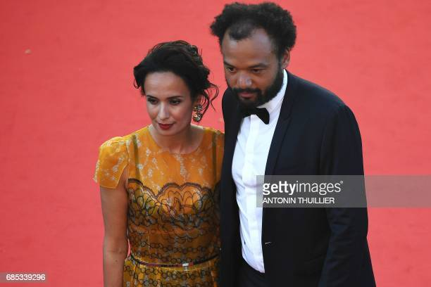 French comedian Fabrice Eboue and his wife Amelle Chahbi pose as they arrive on May 19 2017 for the screening of the film 'Okja' at the 70th edition...