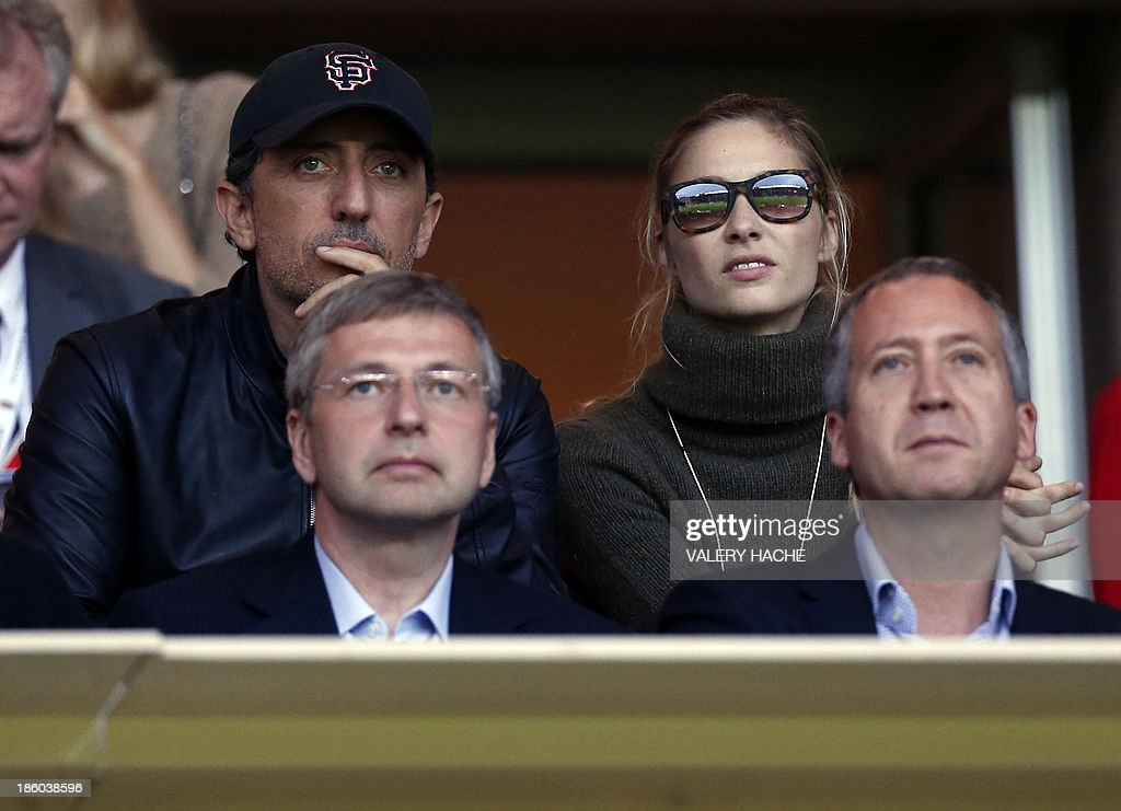 French comedian Gad Elmaleh, Monaco's Russian football club president Dmitriy Rybolovlev, Pierre Casiraghi's girlfriend Beatrice Borromeo, and Monaco's sporting director Vadim Vasilyev attend the French L1 football match Monaco (ASM) vs Lyon (OL) on October 27, 2013 at the Louis II Stadium in Monaco.