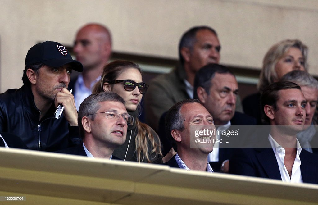 French comedian Gad Elmaleh, Monaco's Russian football club president Dmitriy Rybolovlev, Pierre Casiraghi's girlfriend Beatrice Borromeo, Monaco's sporting director Vadim Vasilyev and Princess Caroline's son Pierre Casiraghi, attend the French L1 football match Monaco (ASM) vs Lyon (OL) on October 27, 2013 at the Louis II Stadium in Monaco.