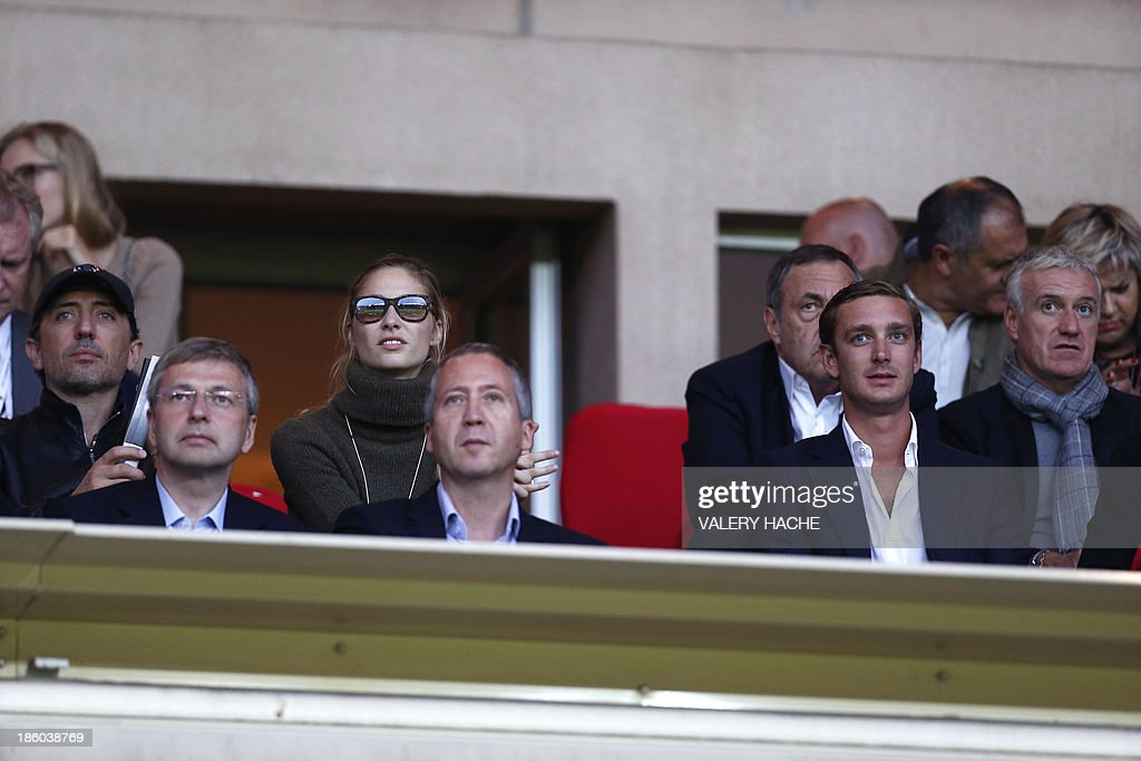 French comedian Gad Elmaleh, Monaco's Russian football club president Dmitriy Rybolovlev, Pierre Casiraghi's girlfriend Beatrice Borromeo, Monaco's sporting director Vadim Vasilyev, Princess Caroline's son Pierre Casiraghi, and France's national football team coach <a gi-track='captionPersonalityLinkClicked' href=/galleries/search?phrase=Didier+Deschamps&family=editorial&specificpeople=213607 ng-click='$event.stopPropagation()'>Didier Deschamps</a> attend the French L1 football match Monaco (ASM) vs Lyon (OL) on October 27, 2013 at the Louis II Stadium in Monaco.