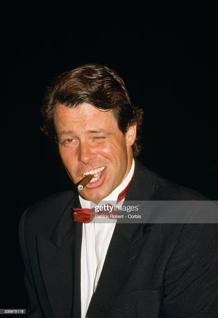French Comedian Michel Leeb Smokes a Cigar