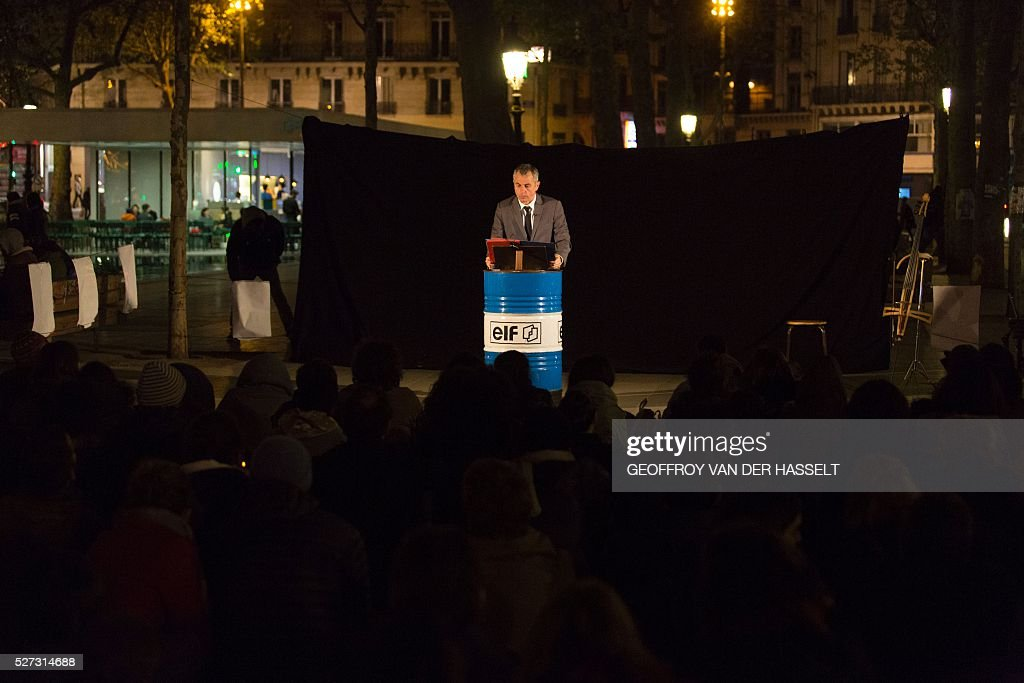A man performs in a play on Place de la Republique in Paris on May 2, 2016, where the 'Nuit debout' movement has been gathering since March 31. A wave of protests over planned labour reforms inspired a new youth movement dubbed 'Nuit Debout' (Up All Night) that kicked off on March 31. It has since embraced a range of grievances, spreading from Paris to several other cities. / AFP / Geoffroy Van der Hasselt
