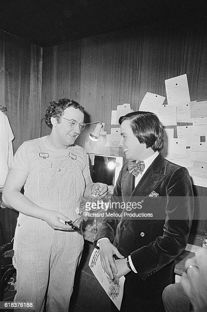 French comedians Coluche and Thierry Le Luron meet in the dressing room backstage at the Olympia Coluche had performed a show at the famous concert...