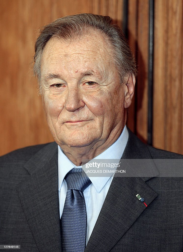 French comic book illustrator and scriptwriter Albert Uderzo, the 'father' of 'Asterix the Gaul' poses after receiving a trophy to mark the 350 millionth copy of the 34 Asterix books sold worldwide, at the Hachette book group headquarters in Paris on September 26, 2011.