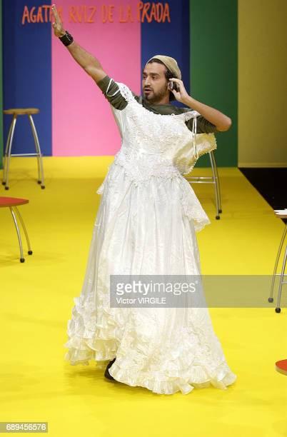 French comic Cyril Hanouna disturbs by walking the runway in a wedding dress the Agatha Ruiz de la Prada Ready to Wear Spring Summer 2003 show as...