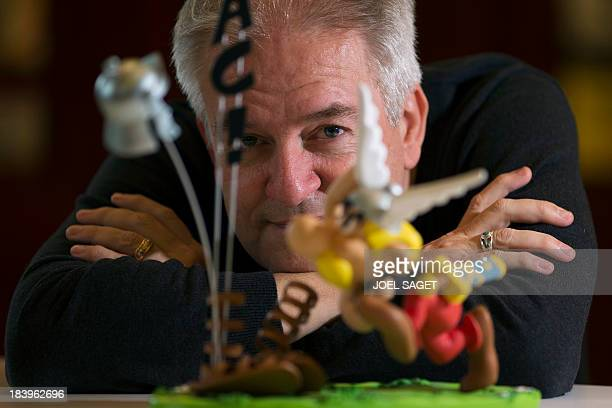 French comics artist Didier Conrad who is to take over the successful comic strip Asterix poses on October 10 2013 in NeuillysurSeine outside Paris...