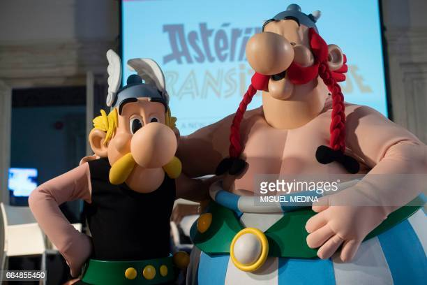 French comics characters Asterix and Obelix pose during a press conference to present 'Asterix et la Transitalique' the 37th album of the Asterix...