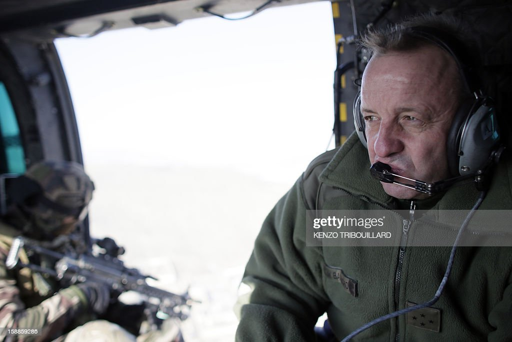 French commander in Afghanistan, General Olivier de Bavinchove (R) sits in a military helicopter flying above Kabul on January 01, 2013.