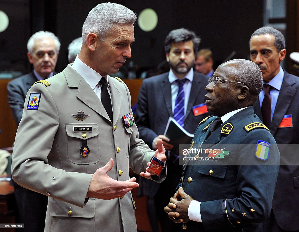 French commander of the EU training mission in Mali Francois Lecointre chats with Ivoirian chief of Staff Soumaïla Bakayoko (R) talk prior to a ministerial meeting of the 'follow-up group' on Mali, at the EU headquarters in Brussels on February 5, 2013. International governments and agencies met to discuss how to restore stability to Mali, amid fears the country will need longterm aid following a military campaign to drive out Islamist fighters who controlled the north of the country for 10 months.
