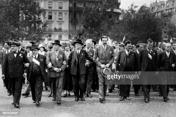 French Communist Party leaders among them Jacques Duclos Marcel Cachin Paul Rivet Benoit Frachon and Maurice Thorez march ahead the massive...