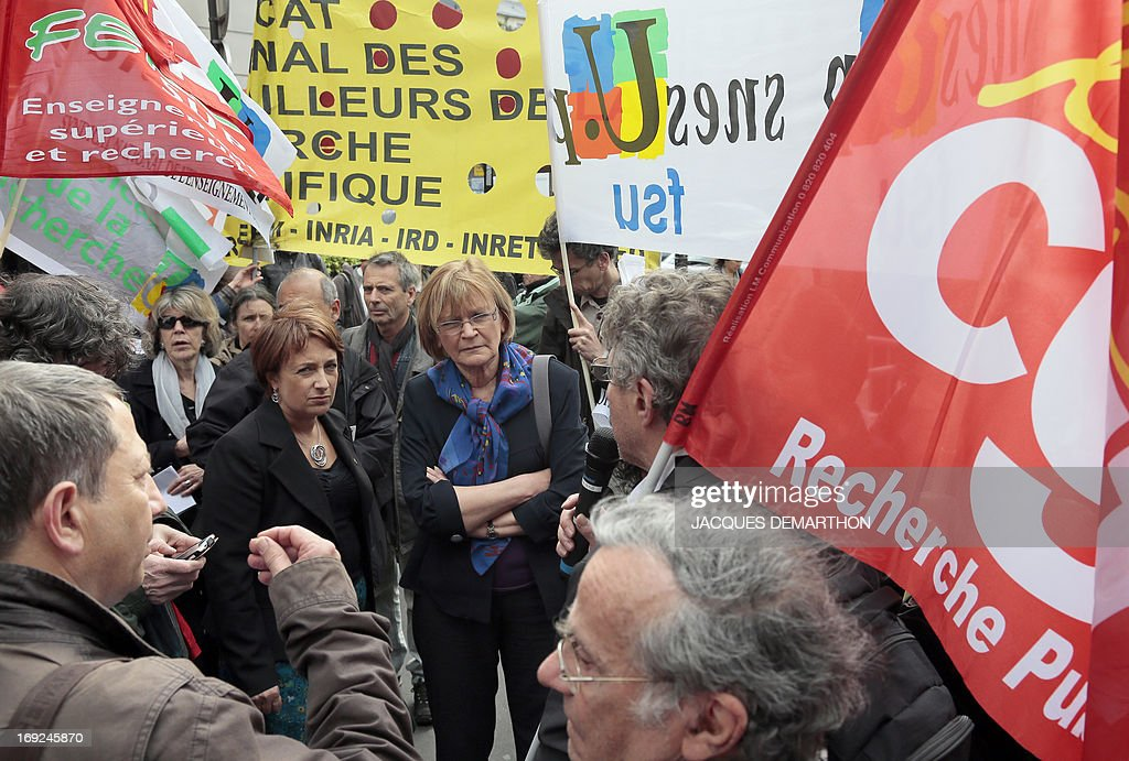 French Communist Party (PCF) member of parliament Marie-George Buffet (C) listens to a CGT unionist speaking during a demonstration in front of the National Assembly on May 22, 2013 in Paris, to protest against a draft law by the French government for higher education. France's lower house will start debating a proposal on May 22 to introduce more courses in English at universities, amid a storm of controversy in a nation fiercely protective of its identity.