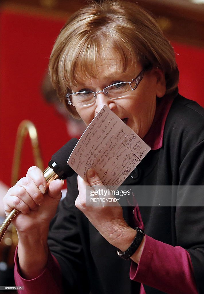 French Communist Party (PCF) MP Marie-George Buffet holds a paper note in front of the microphone as she speaks during the debate on legalising same-sex marriage at the National Assembly on February 7, 2013 in Paris. France's Parliament began examining draft legislation on same-sex marriage after months of rancorous debate and huge street protests by both supporters and opponents. The proposed law still faces at least another week of scrutiny before a final vote scheduled for February 12, it now looks set to emerge from parliament without delay and undiluted.