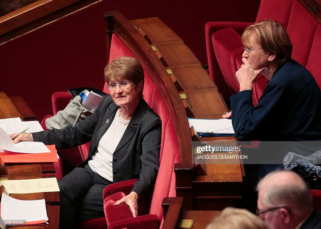 French Communist Party (PCF) MPs Jacqueline Fraysse (L) and Marie-George Buffet attend a debate at the French National Assembly in Paris on February 9, 2016, as French lawmakers examined proposed changes to the constitution. France's lower house of parliament is to vote on plans to enshrine a state of emergency into the constitution, including a controversial measure to strip French nationality from those convicted of terrorism and serious crimes. / AFP / JACQUES DEMARTHON