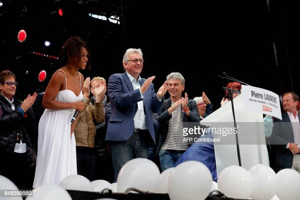 French Communist Party national secretary Pierre Laurent applauds after his speech during the 82nd edition of the annual 'Fete de l'humanite' music...